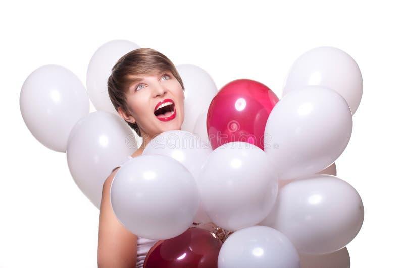 Junge hübsche Frau mit weißen baloons lizenzfreie stockfotos
