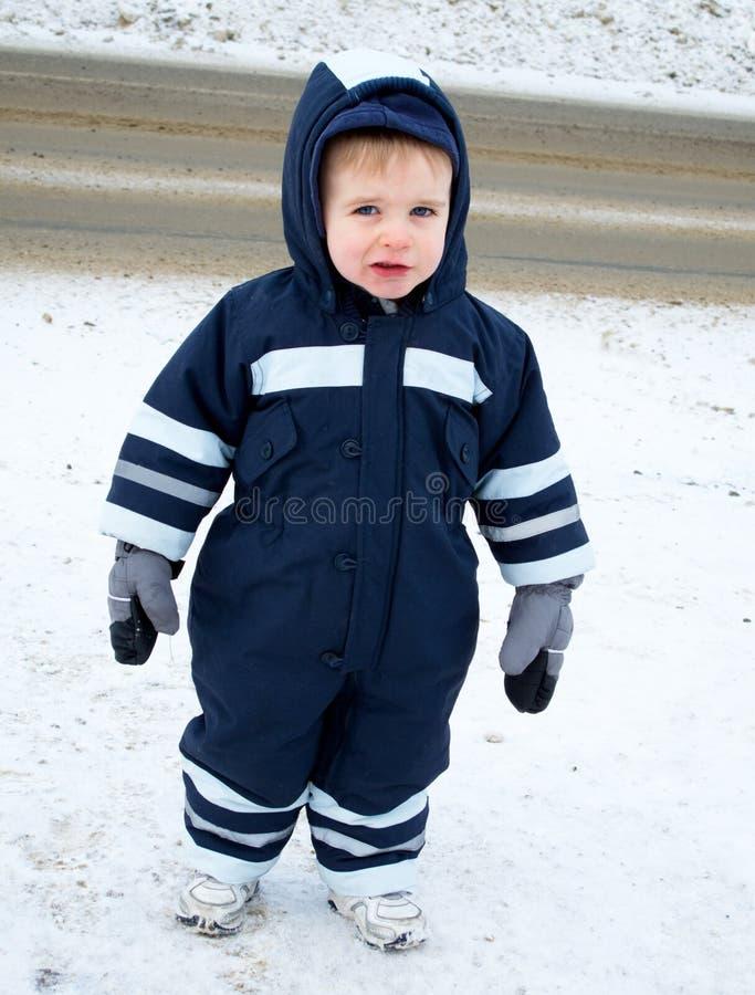 Junge im Snowsuit lizenzfreies stockbild