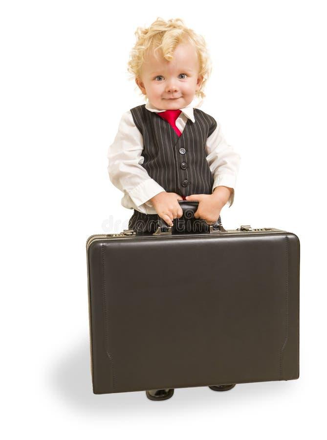 Junge im Westen-Anzug und Bindung mit Aktenkoffer auf Weiß stockfotos