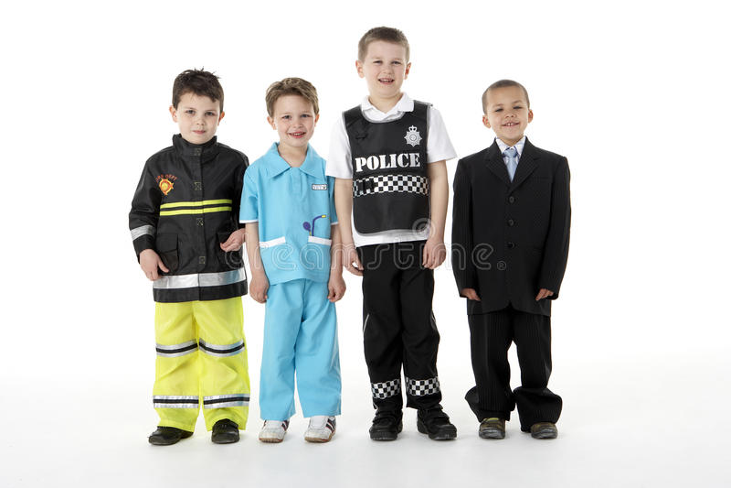 Junge Kinder, die oben als Berufe ankleiden lizenzfreies stockfoto