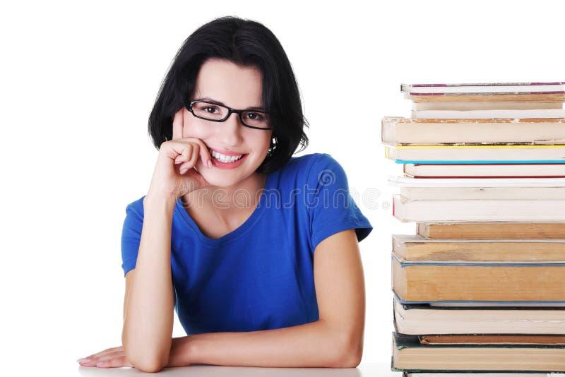 Download Junge Kursteilnehmerfrau Mit Büchern Stockfoto - Bild von buch, verschiedenartigkeit: 27729348