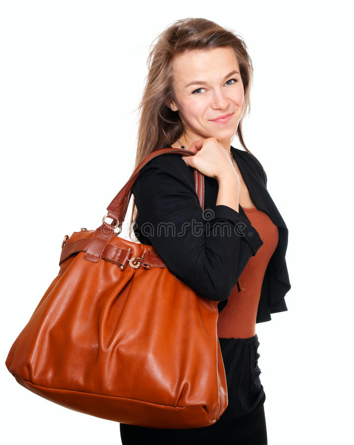 Junge lächelnde Frau mit Handtasche stockfotos