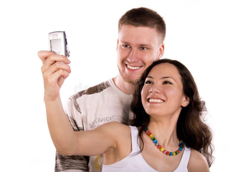 Junge Leute machen ein Foto von selbst stockfotografie