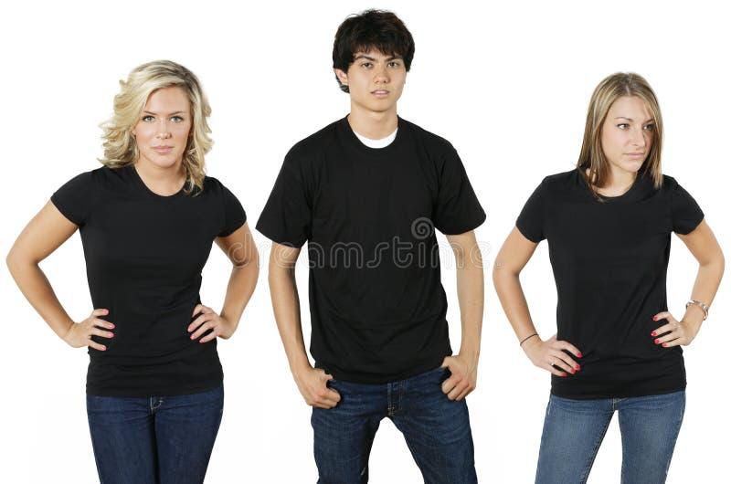 Junge Leute mit unbelegten Hemden lizenzfreies stockbild