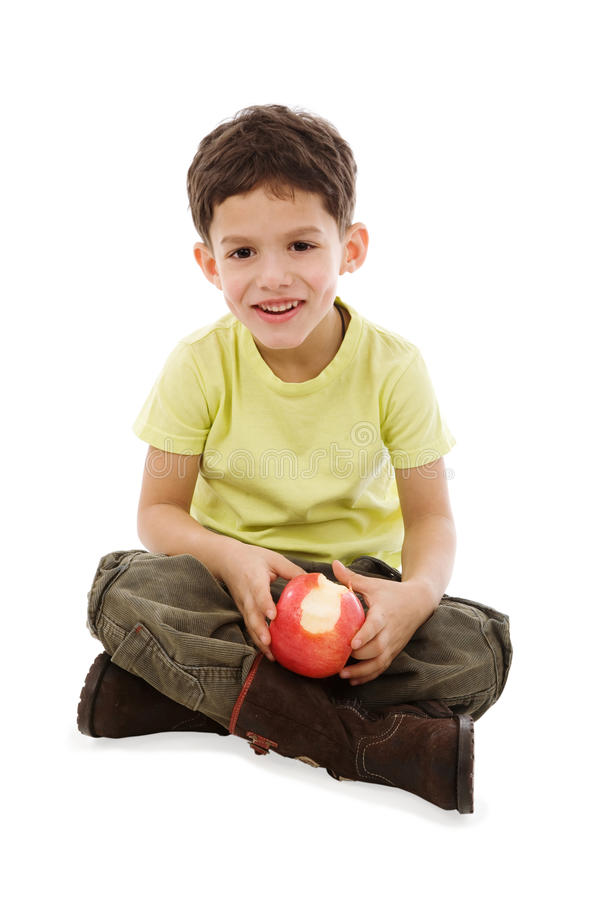 Junge mit Apfel stockfotografie