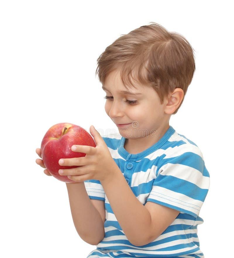 Junge mit Apfel stockbild