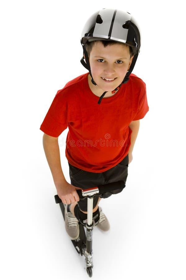 Junge mit dem Roller stockbilder