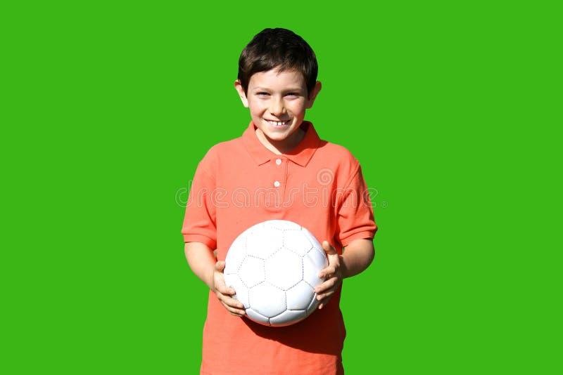 Junge mit der Kugel. lizenzfreie stockbilder