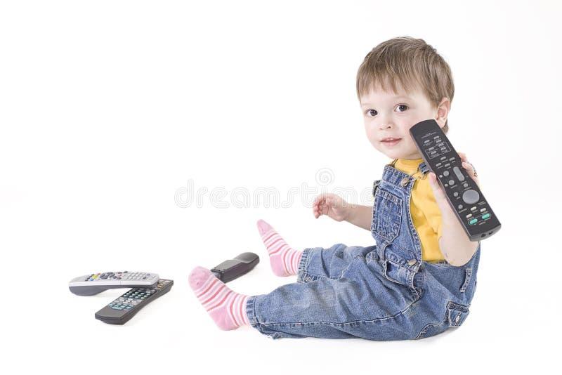 Junge mit Fernsteuerungs lizenzfreie stockbilder