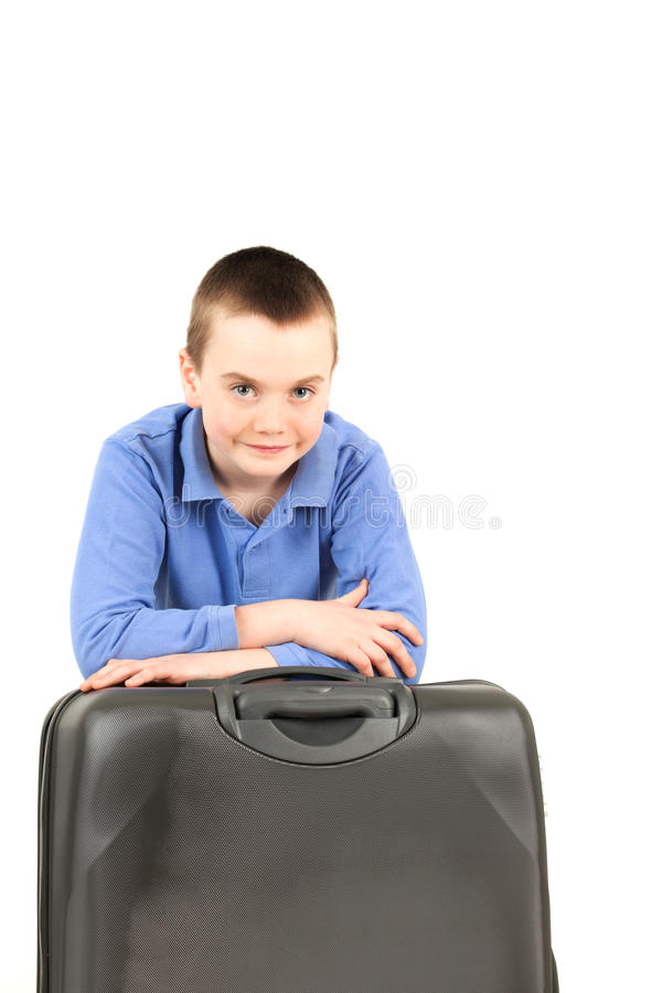 Junge mit Gepäck lizenzfreie stockfotografie