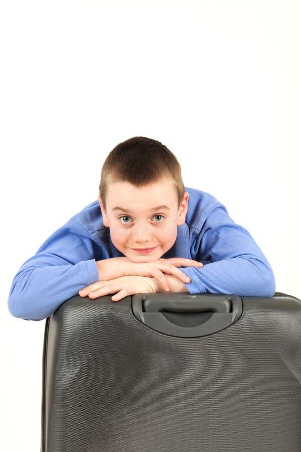 Junge mit Gepäck lizenzfreies stockbild