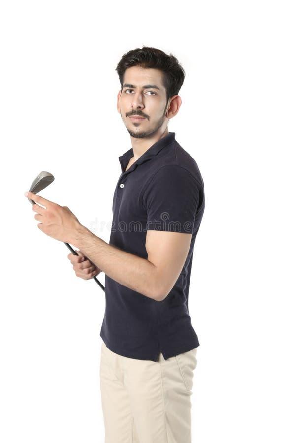 Junge mit Golfstock in der Hand lizenzfreies stockfoto