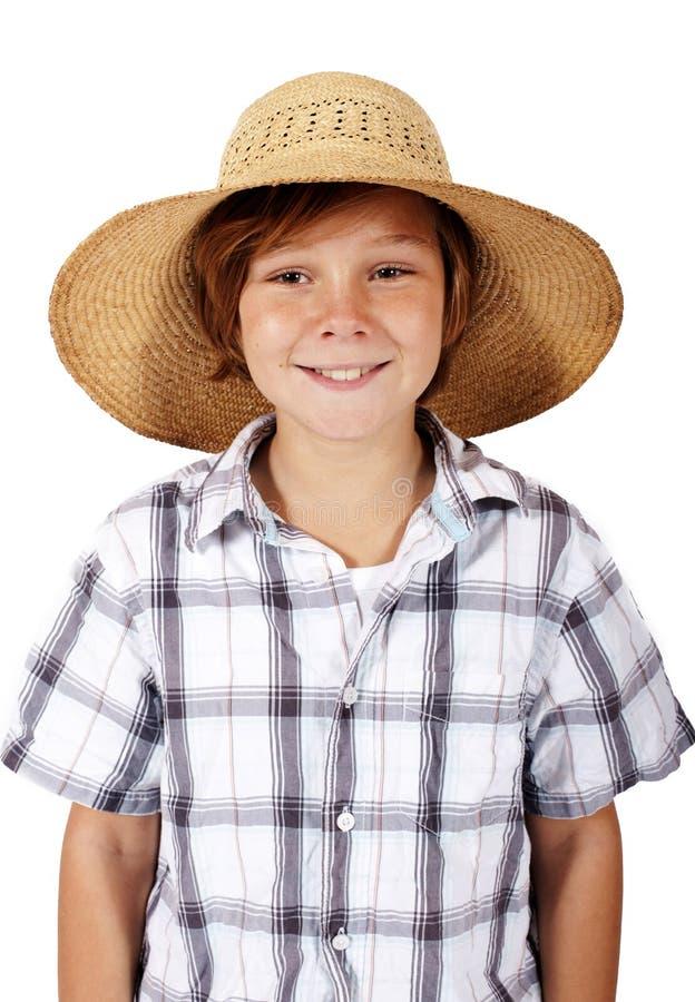 Junge mit Hut lächelt lizenzfreie stockfotos