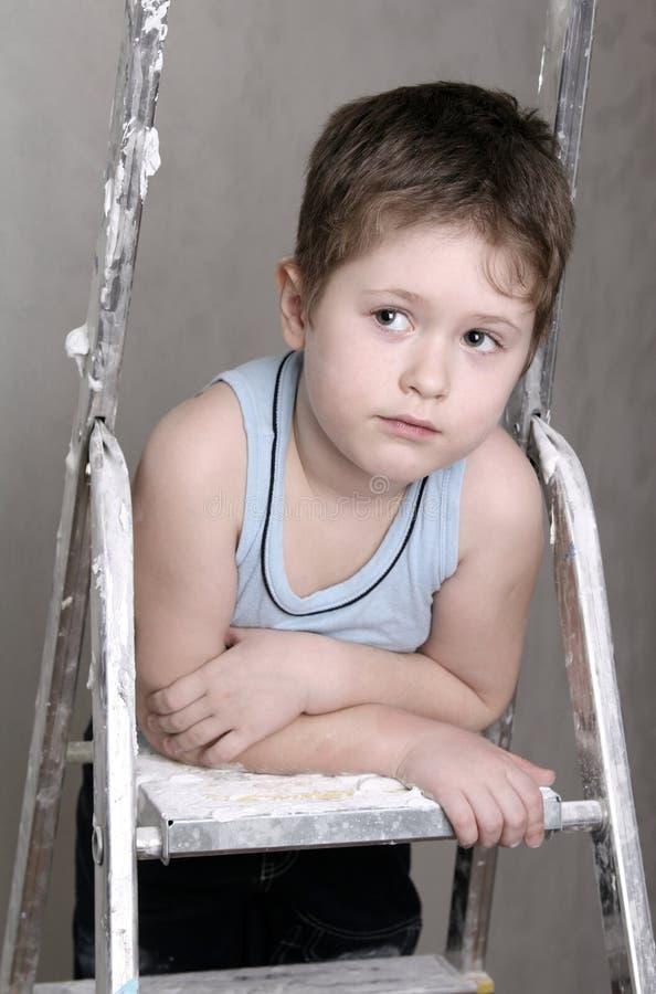 Junge mit Palettemesser stockbilder