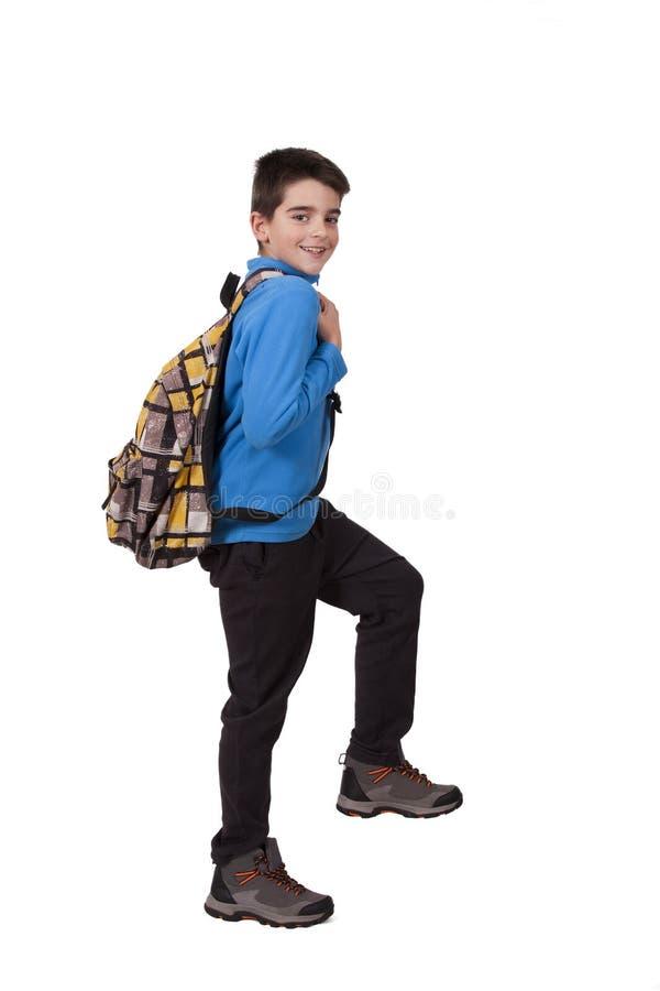 Junge mit Schulebeutel stockfotografie