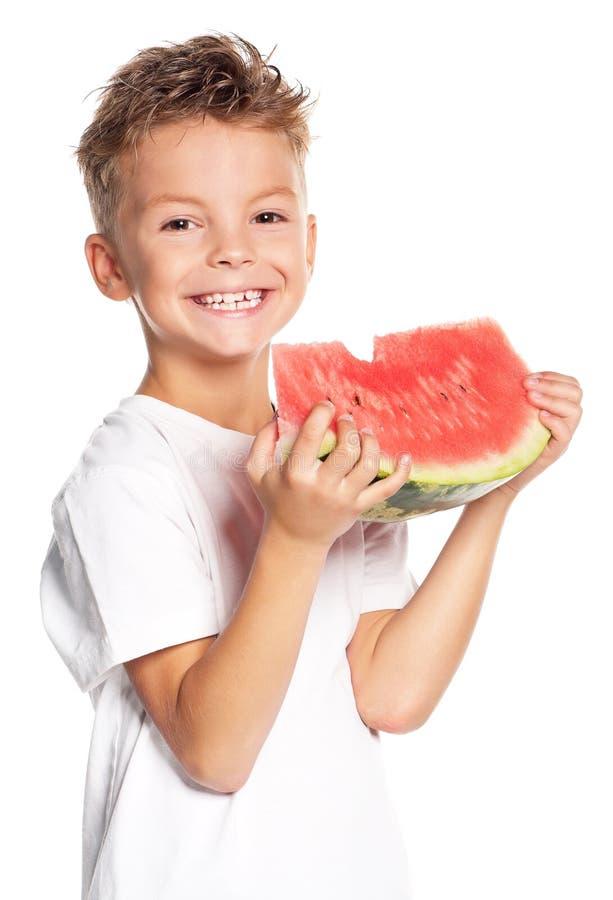 Junge mit Wassermelone lizenzfreie stockbilder