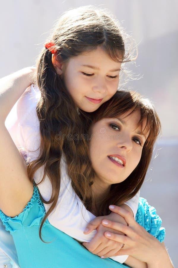 Junge Mutter stockbild