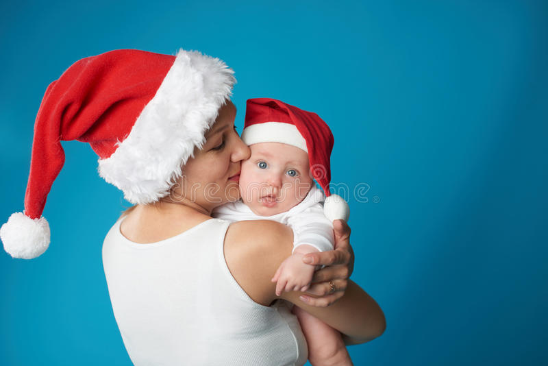 Junge Mutter mit ihrem süßen Baby stockbild