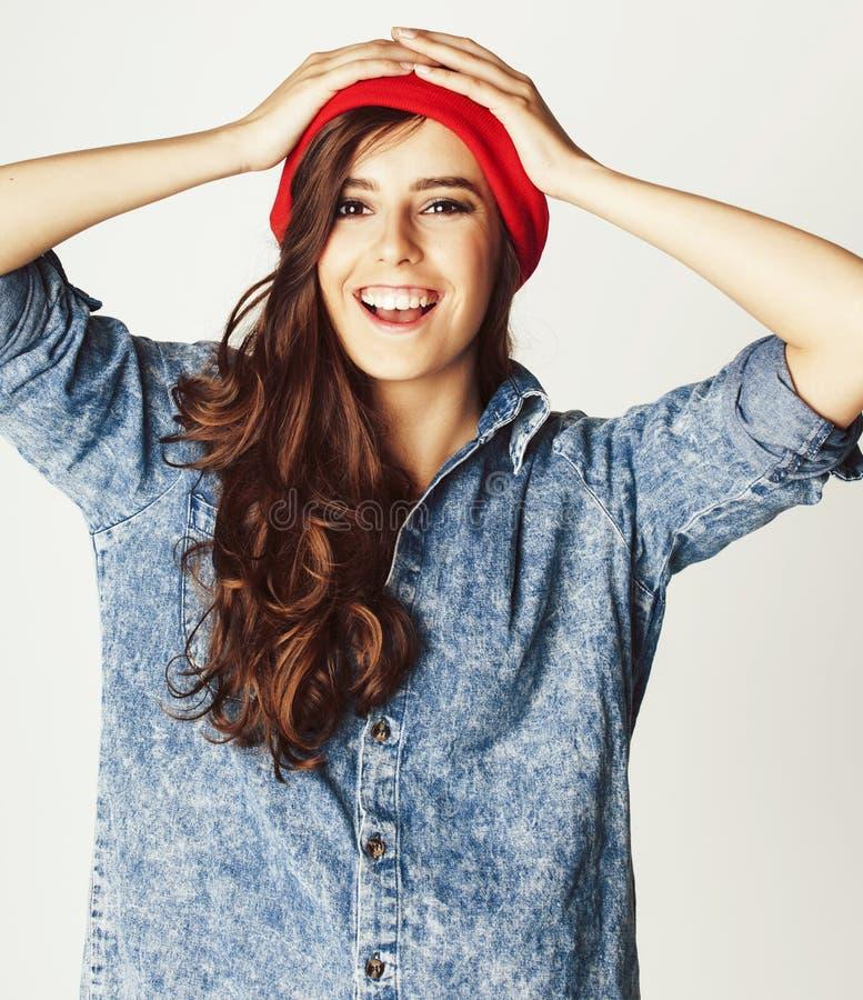 Junge nette Brunettejugendliche auf wei?em Hintergrund lizenzfreie stockfotos