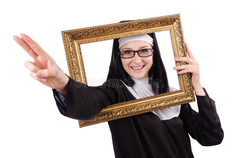Junge Nonne mit dem Rahmen lokalisiert stockbild