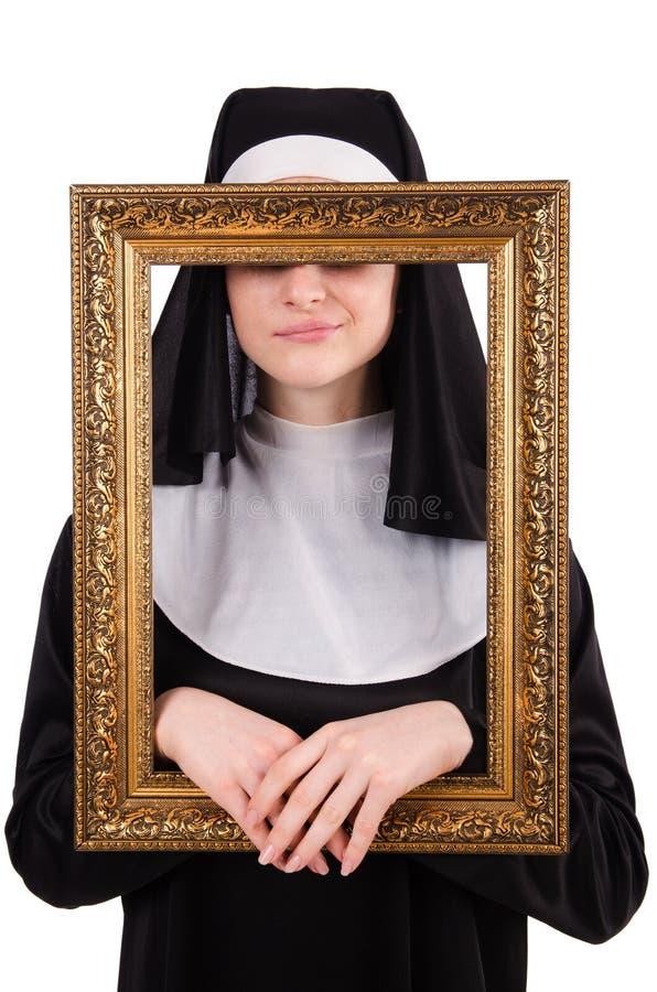 Junge Nonne mit dem Rahmen lokalisiert lizenzfreies stockfoto