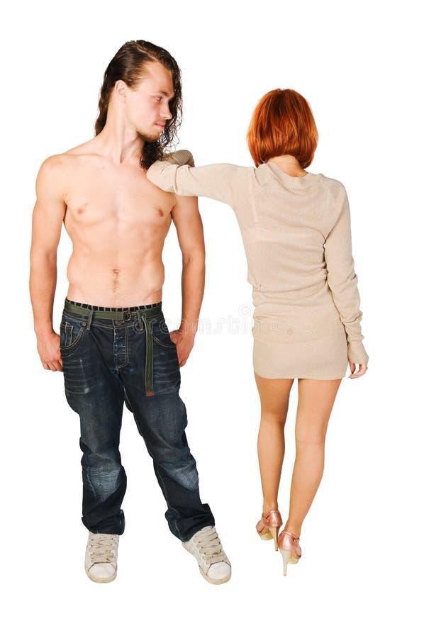 Junge Paare auf normalem Hintergrund stockbild