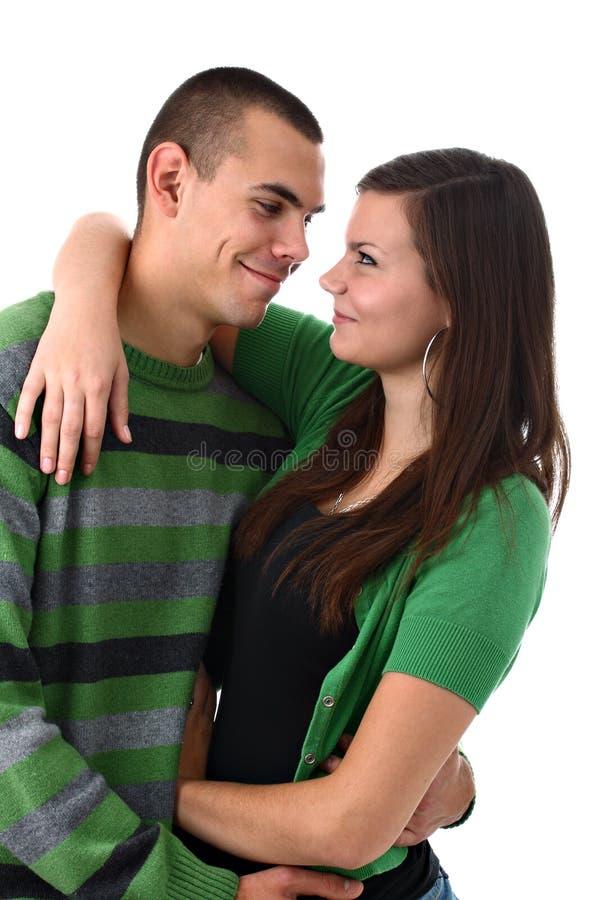 Junge Paare in der Liebe getrennt auf Weiß stockbilder