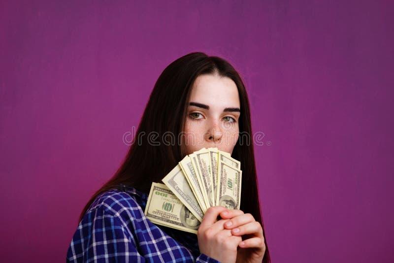 Junge Reiche mit Geld stockfotografie