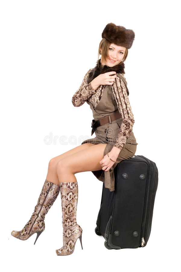Junge schöne Dame mit einem Koffer stockfoto