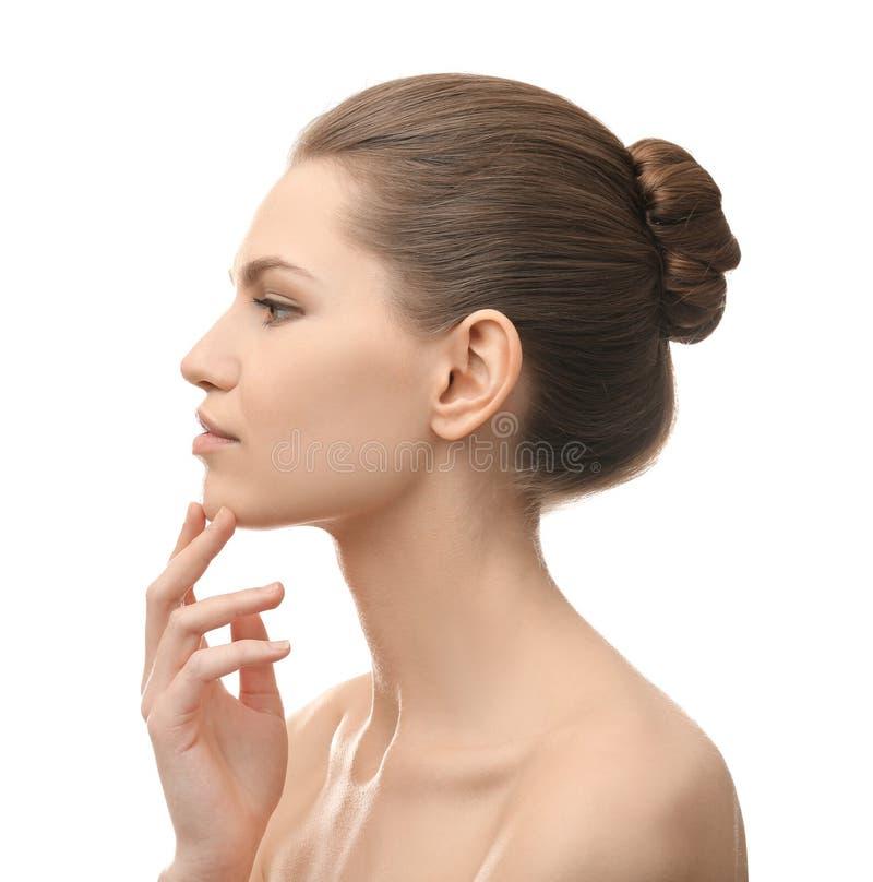 Junge schöne Frau auf weißem Hintergrund stockfoto