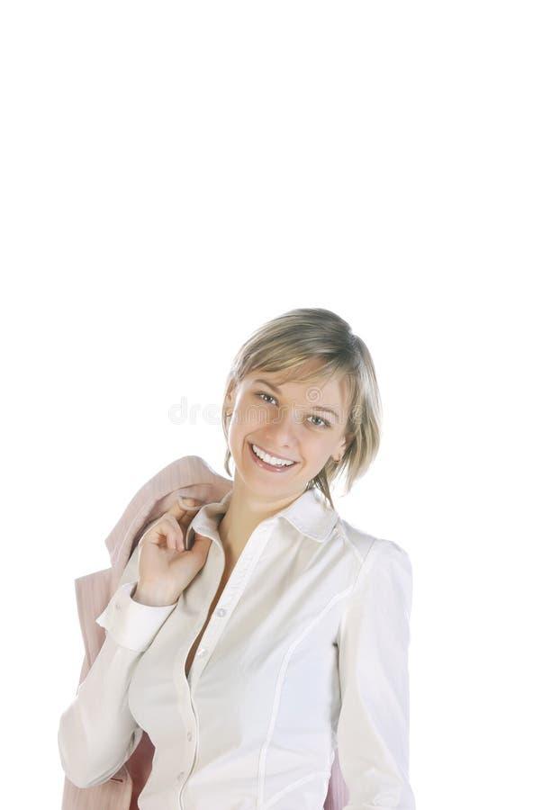 Junge schöne Frau, die eine Jacke anhält lizenzfreie stockbilder