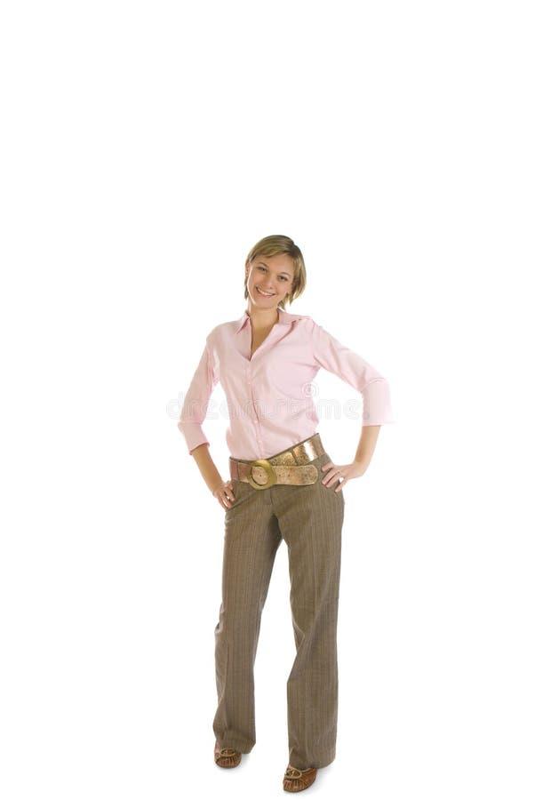 Junge schöne Frau in einem rosafarbenen Hemd lizenzfreie stockfotos