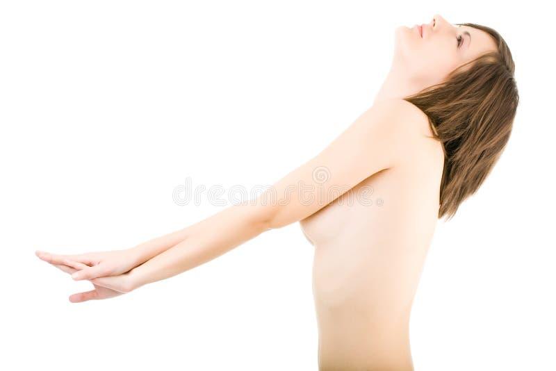 Junge schöne nackte Frau auf Weiß