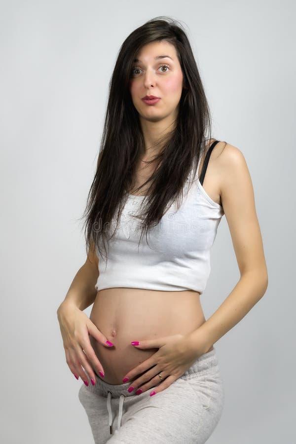 Junge-schwangere Frau stockfoto