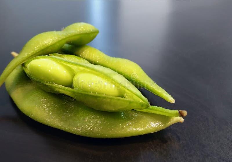 Junge Sojabohnenöl-Bohnen in den Hülsen für japanisches Snack ` Edamame-` lizenzfreies stockbild