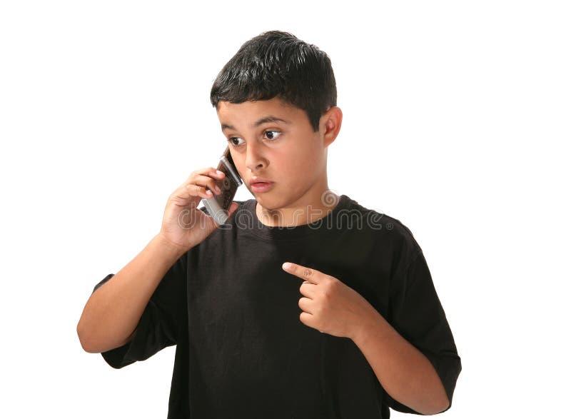 Junge am Telefon stockbild