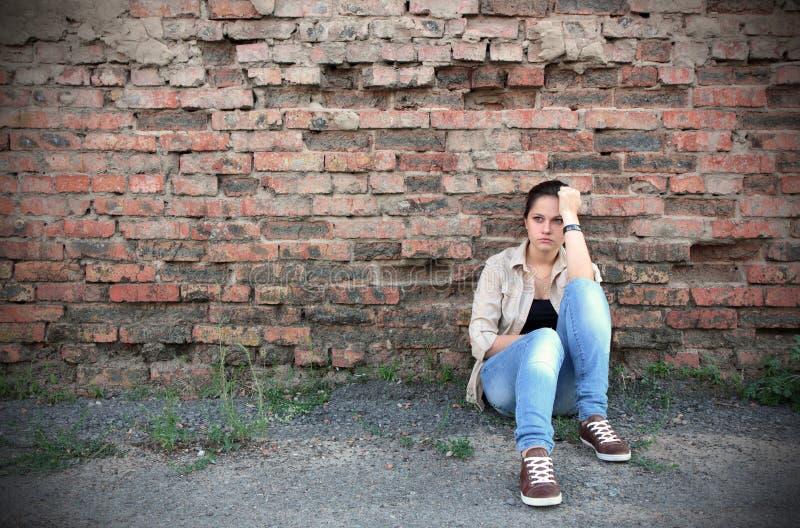Junge traurige Frau stockbild