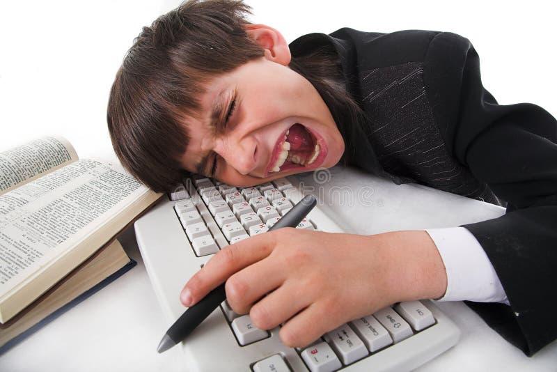 Junge und Computer stockfoto