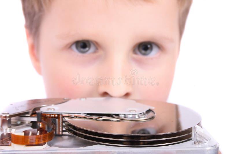 Junge und Festplattenlaufwerk stockfoto