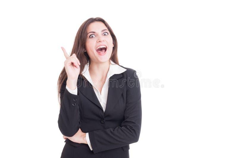 Junge und schöne Geschäftsfrau, die eine neue großartige Idee hat lizenzfreie stockfotos