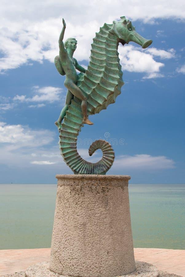 Junge und Seahorse stockbild