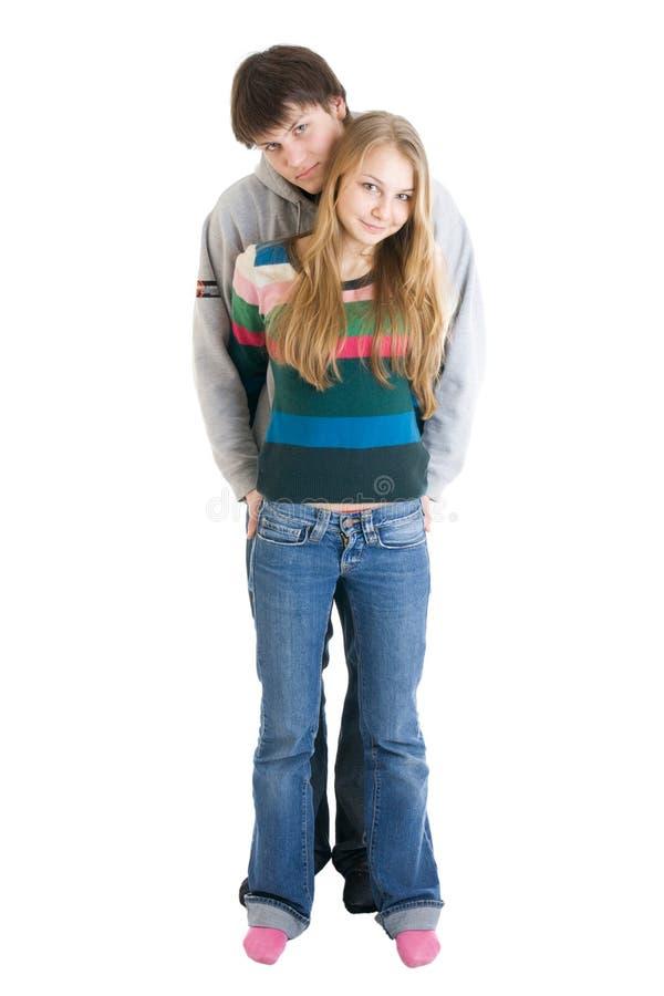 Junge, welche die Paare getrennt auf einem Weiß umfassen lizenzfreie stockbilder