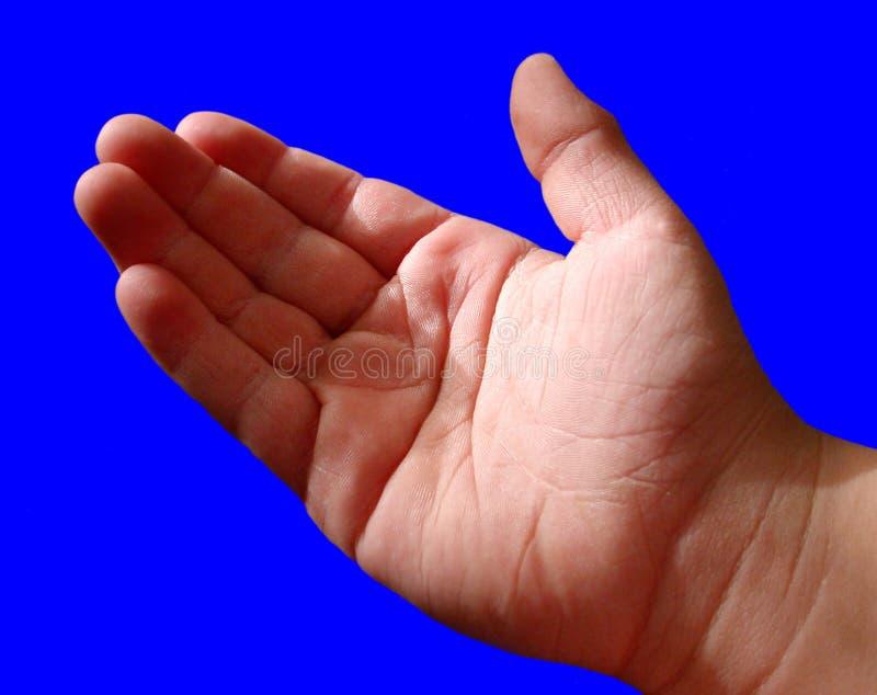 Jungen übergeben auf Blau lizenzfreies stockbild
