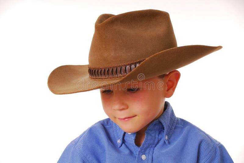 Jungen-Cowboy stockfotografie