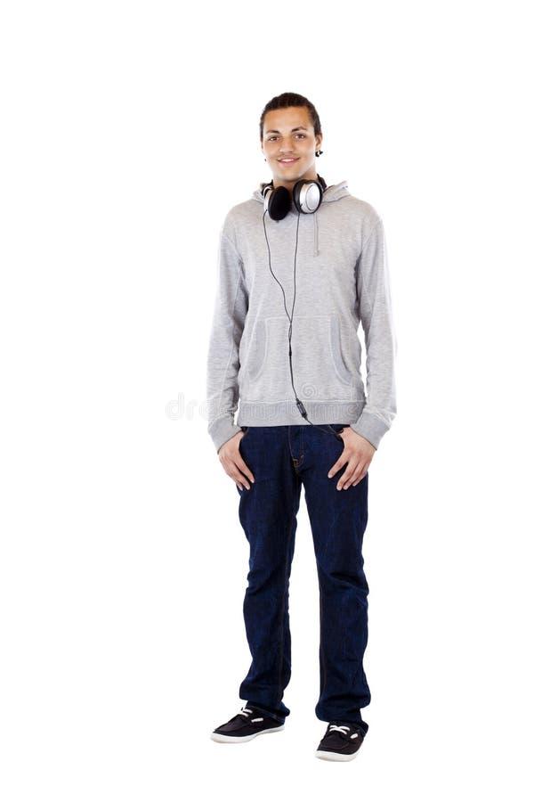Junger amerikanischer Mann mit den Kopfhörerblicken glücklich stockbilder