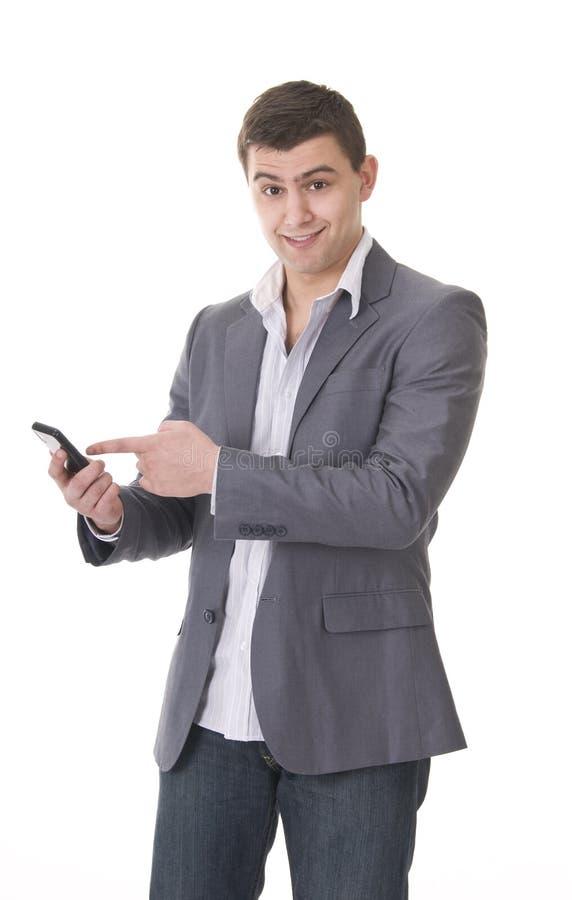 Junger beiläufiger junger Mann mit Telefon lizenzfreie stockfotos