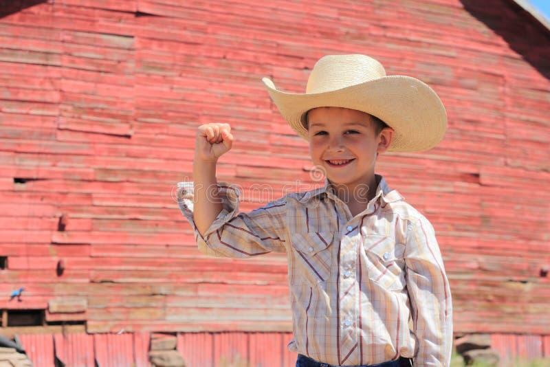 Junger biegender Cowboy stockbild