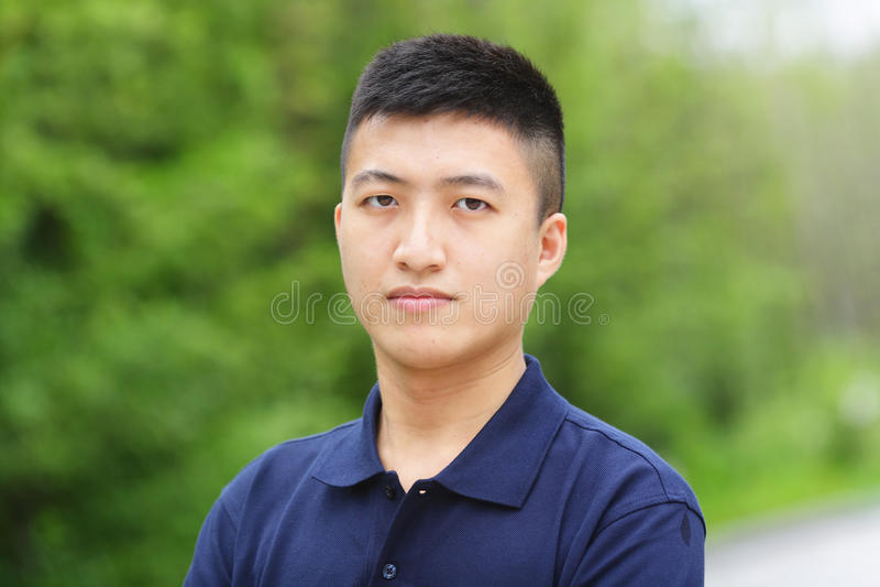 Junger chinesischer Mann stockbild