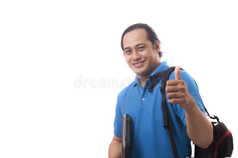 Junger erfolgreicher gl?cklicher Student Shows Thumb Up lizenzfreie stockfotos