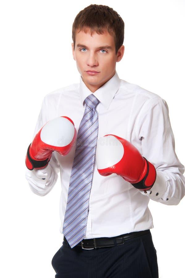 Junger Geschäftsmann in den Verpackenhandschuhen lizenzfreie stockbilder